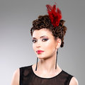 Woman with fashion hairstyle with red feather in hairs beautiful adult Royalty Free Stock Photos