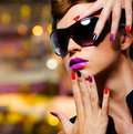 Woman with fashion manicure and black sunglasses face of young Stock Photos