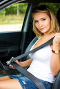 Woman fastens a seat belt in car Stock Image