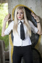 Woman in fear young shirt and tie standing at the wall surrendering pose expression Royalty Free Stock Images