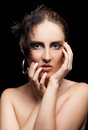 Woman with feather and goth make up on black background Royalty Free Stock Photo