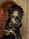 Woman with feather mask in a costume in front of an old door Royalty Free Stock Photos