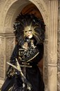 Woman with feather mask in a costume in venice Stock Photography