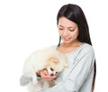 Woman feed her dog isolated on white background Royalty Free Stock Photo
