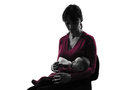 Woman feeding bottle baby silhouette one caucasian women on white background Stock Photos