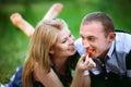 Woman feeding man a strawberry
