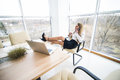 Woman feel relax speak at phone in office Royalty Free Stock Photo