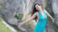 Woman feeling the wind beautiful young on mountain cliff stretching arm and and sun Stock Images