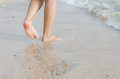 Woman feet on the beach with natural evening light Stock Image