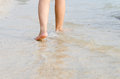 Woman feet on the beach with natural evening light Royalty Free Stock Photos