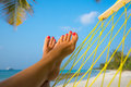Woman feet in hammock on the beach Royalty Free Stock Photo