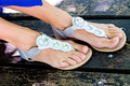 Woman feet in modern summer sandals Stock Photo