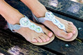 Woman feet in modern summer sandals Royalty Free Stock Photo