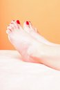 Woman feet with red toenails on towel Royalty Free Stock Image