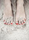 Woman feet on the sand in beach red polished nails Royalty Free Stock Photo
