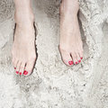 Woman feet on the sand in beach red polished nails Stock Image