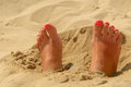 Woman feet on the sand with manicure Royalty Free Stock Image
