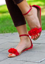Woman feet in sandals pedicured summer style fashion Royalty Free Stock Images