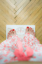 Woman feet on the scales Stock Photos