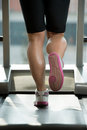 Woman feet on treadmill close up of female legs running blurred motion Royalty Free Stock Photography