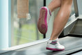 Woman feet on treadmill close up of female legs running blurred motion Royalty Free Stock Images