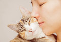 Woman and feline happy is hugging orange tabby Stock Photo