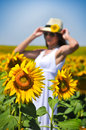 Woman in field with sunflowers Royalty Free Stock Photo