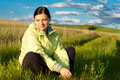 Woman in the field young is sitting grass Stock Images
