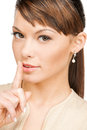 Woman with finger on her lips Stock Image