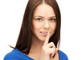 Woman with finger on her lips Royalty Free Stock Photo
