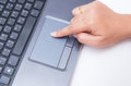 Woman finger touch on laptop using computer Royalty Free Stock Photography