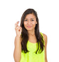 Woman fingers crossed closeup portrait young funny looking crossing wishing praying for miracle hoping for the best isolated white Royalty Free Stock Photos