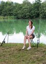 Woman Fishing at a lake Royalty Free Stock Photo