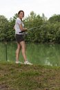 Woman Fishing at a lake Royalty Free Stock Photography