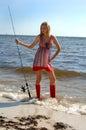 Woman fishing portrait Royalty Free Stock Photo