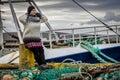 Woman and fishing ship Royalty Free Stock Photo