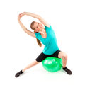 Woman fitball young cheerful smiling exercising with isolated over white background Stock Image