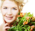Woman fith bright pink yellow flowers young Royalty Free Stock Photos