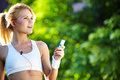 Woman during fitness on city is listen to the music beautiful Royalty Free Stock Photography
