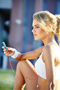 Woman during fitness on city is listen to the music beautiful Stock Photo