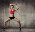 Woman fitness gymnastic exercise sport young girl fit dance modern aerobic dancer grunge wall Royalty Free Stock Photography