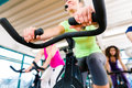 Woman at Fitness Spinning on bike in gym Royalty Free Stock Photo