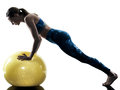 Woman fitness  swiss ball excercises silhouette Royalty Free Stock Photo
