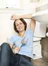 Woman fixing plumbing Stock Images