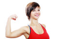 Woman flexing biceps beautiful front view high key shot in studio Royalty Free Stock Image