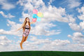 Woman flies balloons clouds Stock Photography