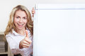 Woman with flipchart holding thumbs Royalty Free Stock Photo