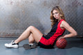 Woman on floor posing with the basket ball Royalty Free Stock Photo