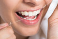 Woman Flossing Teeth At Home Royalty Free Stock Photo