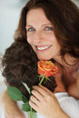 Woman with a flower being caressed by husband Stock Image